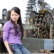 Fashion girl and waterwheel — Stock Photo