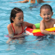 Swimming boy and girl — Stock Photo