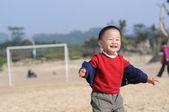 Cute little boy on beach — Stock Photo