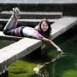 Chinese girl playing by water — Stock Photo #2694204