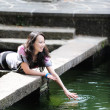 Chinese girl playing by water — Stock Photo #2694217