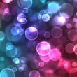 Abstract glowing circles on a colorful backgroun - Stock Photo