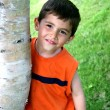 Boy hanging out around Tree — Stock Photo
