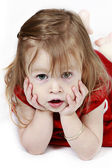 Little girl in red dress with hands on face — Stock Photo