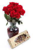 Red Roses in vase with Chocolates — Stock Photo
