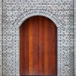 Door in brick wall — Stock Photo