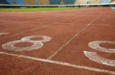 Number on a running track finish line — Stock Photo