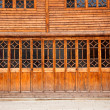 Stock Photo: Closed wooden door and wall