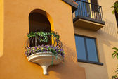Arched door and balcony — Stock Photo