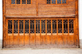 Closed wooden door and wall — Stock Photo