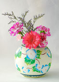 Beautiful flowers in vase — Stock Photo