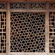 Stock Photo: Old woodcarving of window
