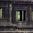 Sculpted wall and windows, Angkor Wat — Stock Photo #1880567