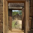 Doorway and sculpted wall in angkor — Stock Photo #1880606