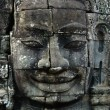 Sculpted stone face in a temple - Stock Photo