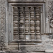 Stock Photo: Sculpted wall, Angkor Wat