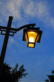 Street light at nightfall — Stock Photo
