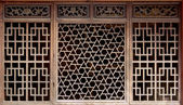 Old woodcarving of window — Stock Photo