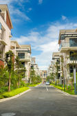 A road and two rows of new terrace house — Stock Photo