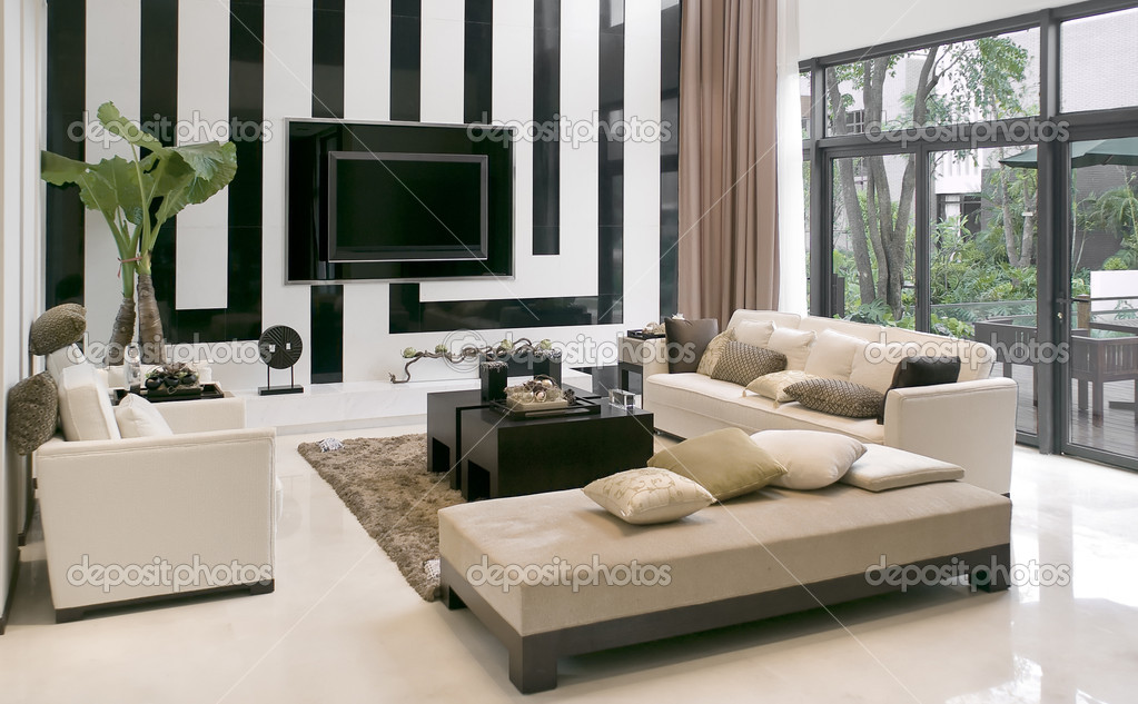 Minimalist modern landscape design with rattan sofa