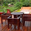 House patio with table and chairs - Stok fotoğraf