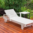 Stock Photo: Wooden reclining chair in garden