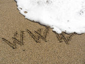 Inscription on sea sand WWW — Stock Photo