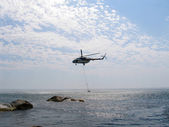 Helicopter above the sea — Stock Photo