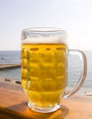Mug of cold beer — Stock Photo