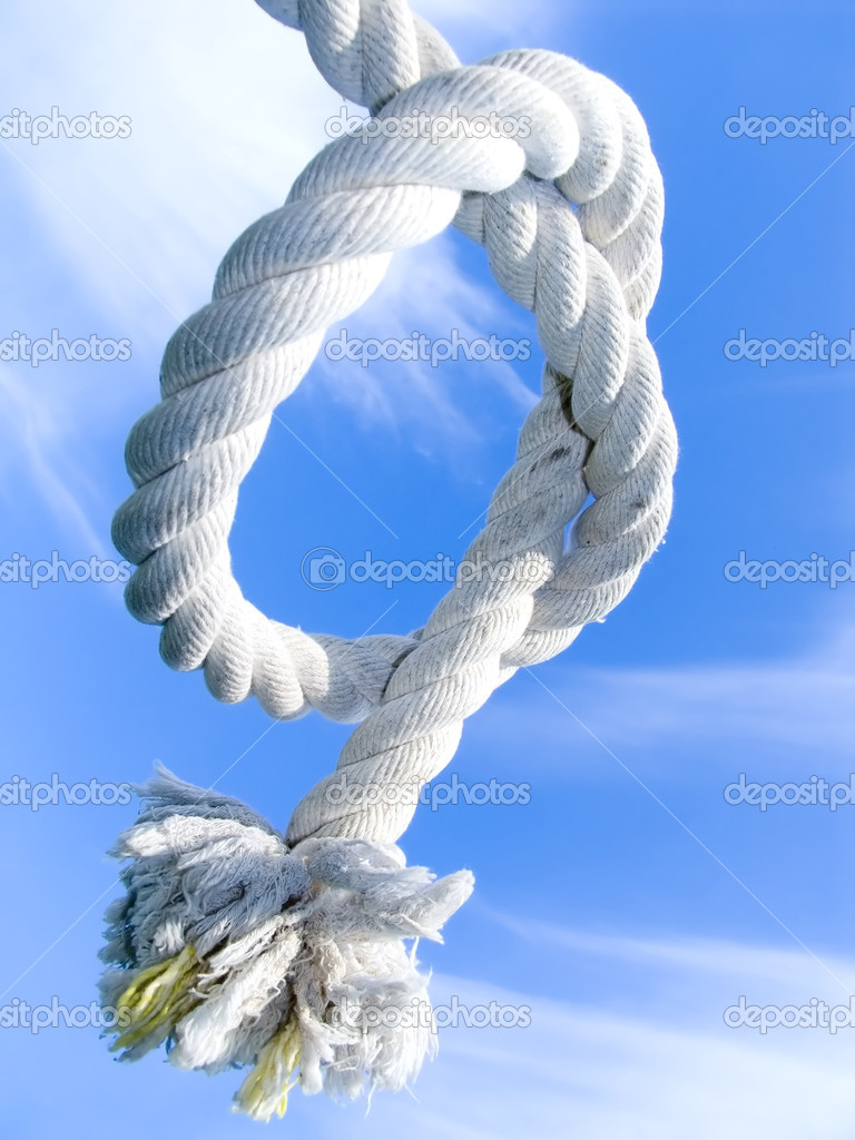 Unit from a rough cord on a background of the blue sky — Stock Photo #1868594