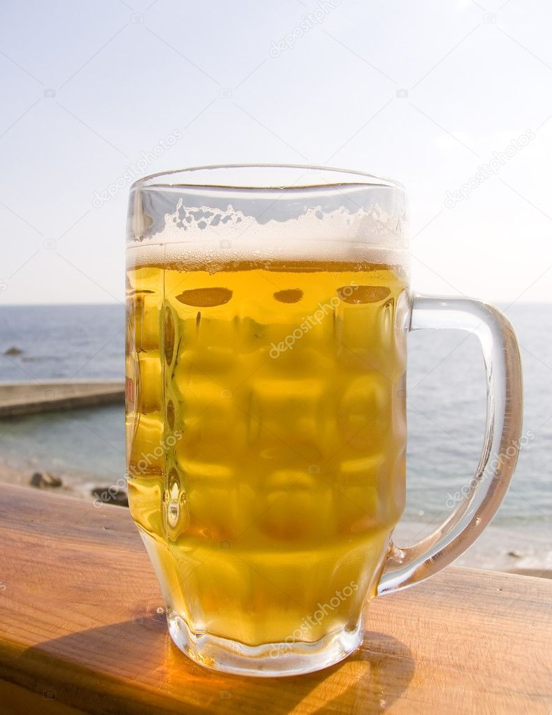 Mug of cold beer on a table in cafe — Stock Photo #1868662