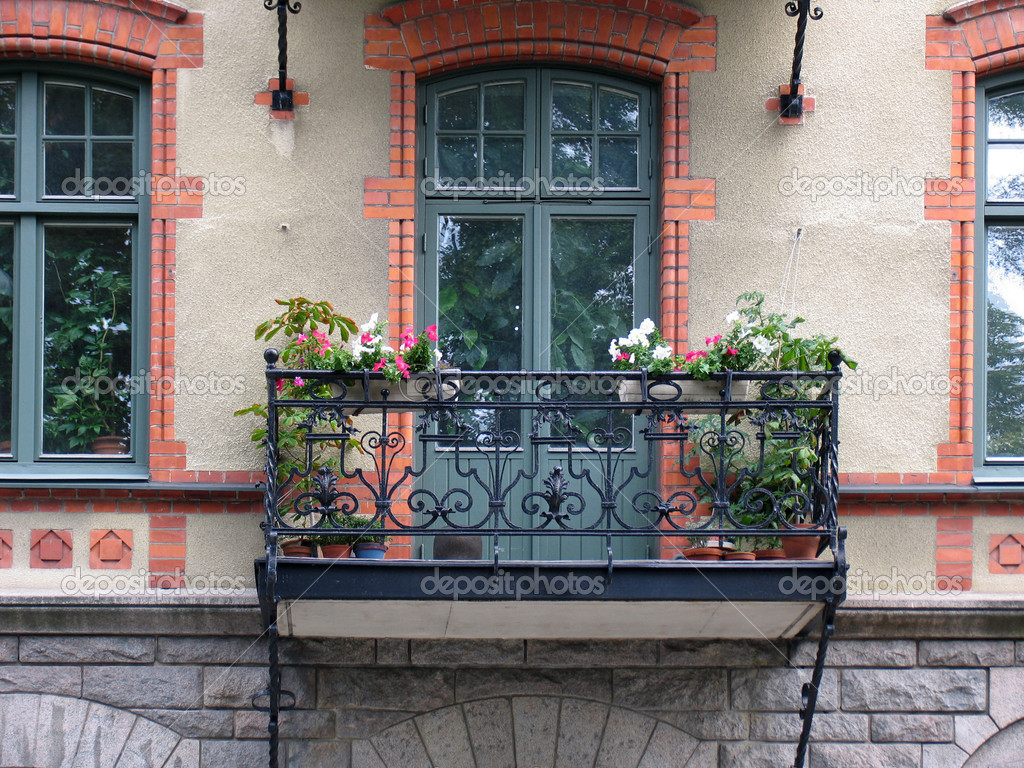 Balcony with a lattice decorated flowers — Stock Photo #2030632