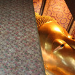 Lying golden Buddha — Stock Photo