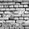 The monochrome brick wall of a house — Stock Photo