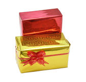 Gift in golden wrapping with red bow — Stock Photo