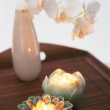 Royalty-Free Stock Photo: Two candles and flower on the wooden table