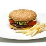 Hamburger and potatoes — Stock Photo