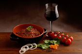 Ragu sauce and glass of wine — Stock Photo
