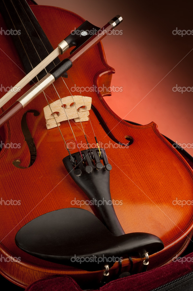 Violin with bow on  red background — Stock Photo #1898433