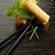 Roll spring with chopsticks — Stock Photo #2172873