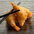 Fried shrimp with chopsticks - Stock Photo