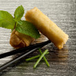 Roll spring with chopsticks — Stock Photo #2173049