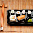 Stock Photo: Dish of Sushi with chopstick
