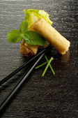 Roll spring with chopsticks — Stock Photo