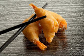 Fried shrimp with chopsticks — Stock Photo