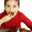 Child eating chocolate cake — Stock Photo