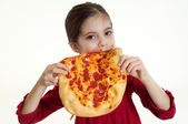 Child eating pizza — Stock Photo