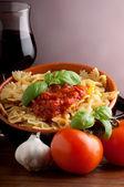 Tomatoes farfalle typical italian pasta — Stock Photo