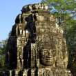 Details of a tower faces of Bayon temple - Stock Photo