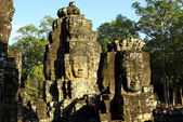 Multiple stone faces on the Bayon Temple — Stock Photo